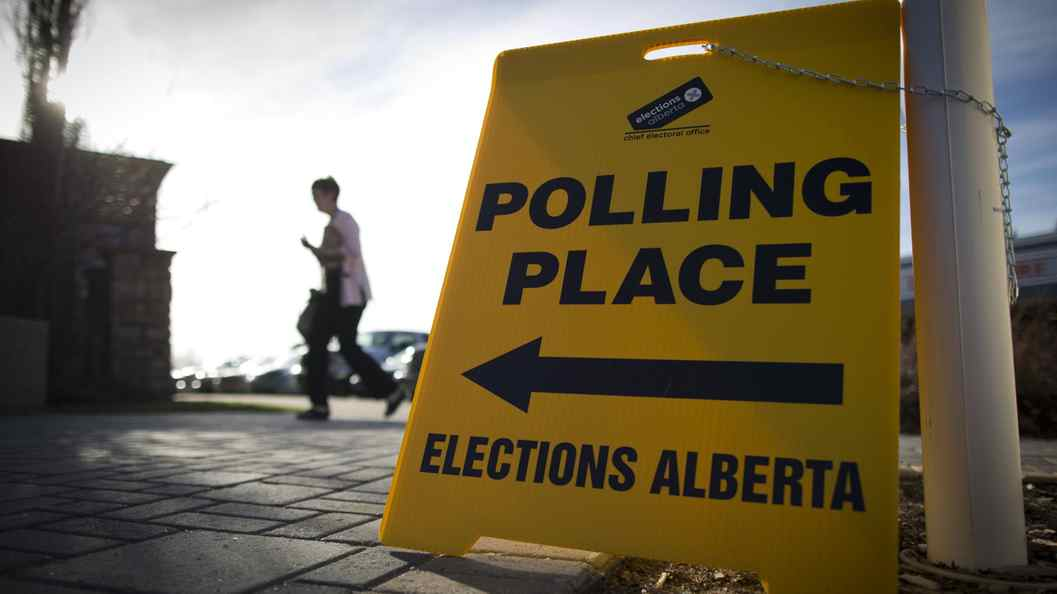 Voters turn up at a polling station in High River, Alberta April 23, 2012.