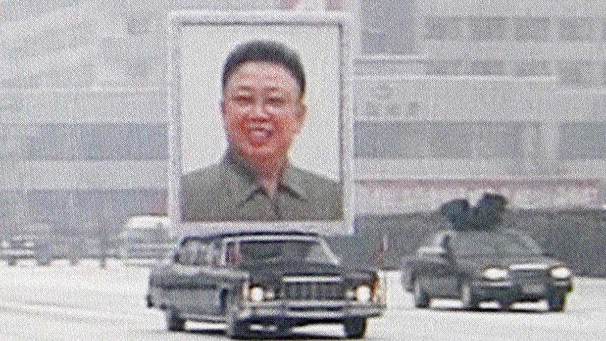 In this image made from KRT video, a huge portrait of late North Korean leader Kim Jong Il is carried during his funeral procession in snowy Pyongyang, North Korea, Wednesday, Dec. 28, 2011.