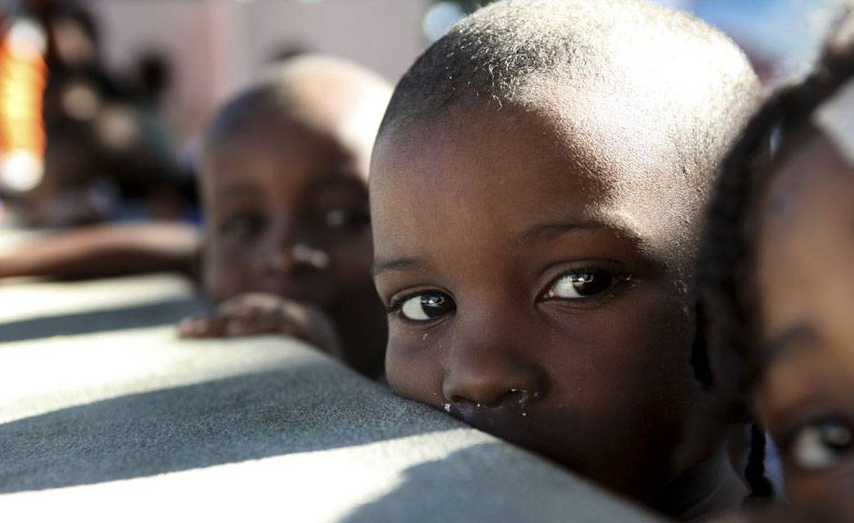 Young children are seen at an orphanage on January 18, 2010 following the earthquake that hit in Port au Prince on January 12, 2010. More than 105,000 food rations have been distributed to victims of Haiti's devastating earthquake since the emergency relief operation began last week, the UN's food relief agency said.