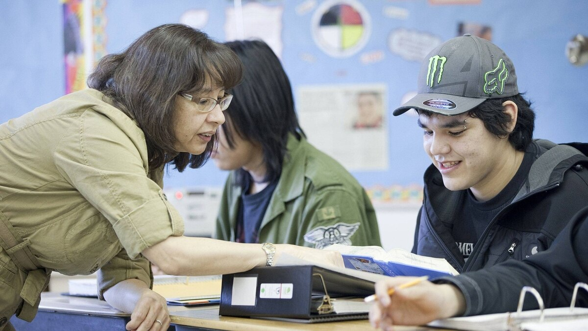 Donna Lafreniere talks with Douglas Fiddler during the English 30 class at the Waweyekisik Educational Centre at Waterhen Lake First Nations on February 2, 2012.