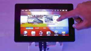 A conference attendee examines the BlackBerry PlayBook during its launch in Mumbai June 22, 2011.