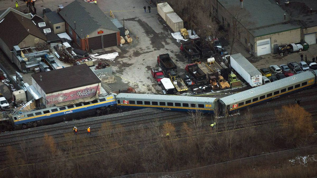Emergency crews attend the scene where a VIA train was derailed with passengers on board in Burlington, Ont.
