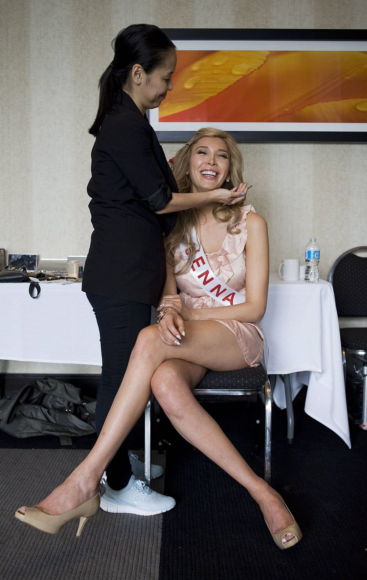 Jenna Talackova, a Canadian transgendered constestant in the Miss Universe pageant, gets ready for a photo shoot at the Sandman Signature Hotel in Toronto on Saturday.