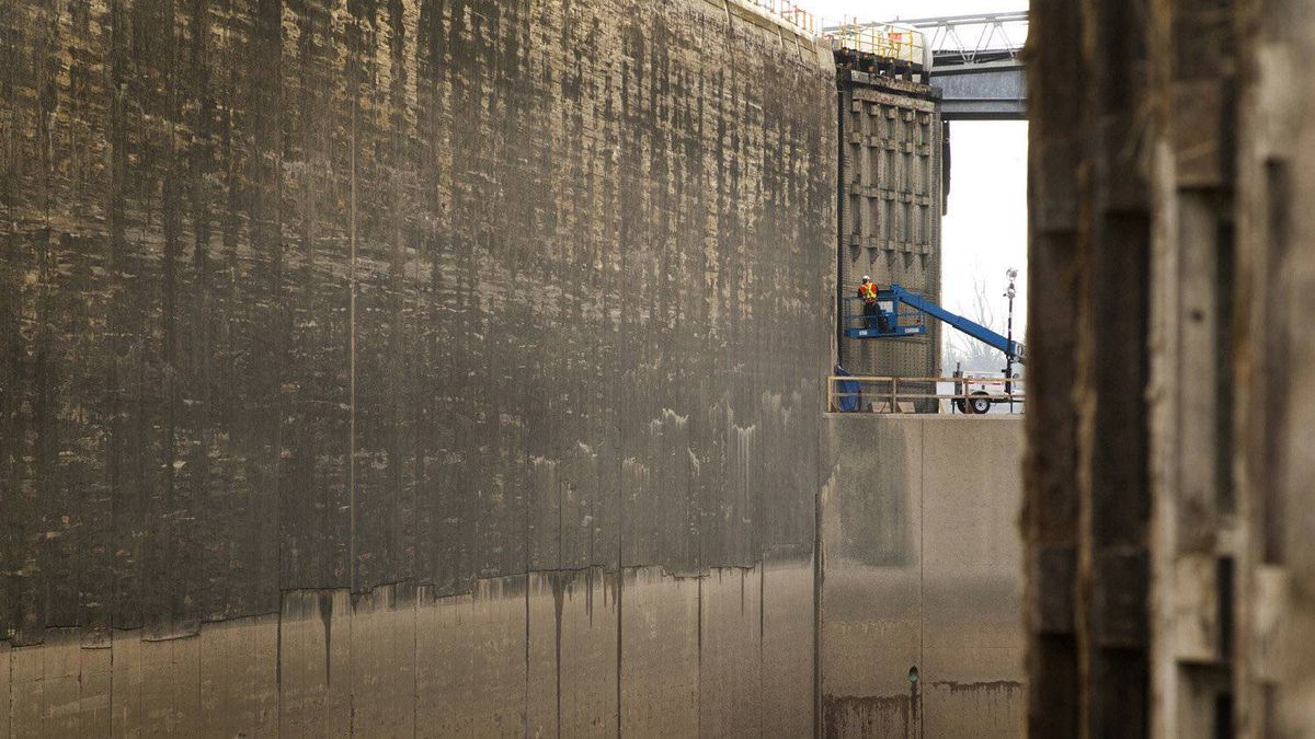 Workers are seen on the upper level of lock #2. The doors are 45 feet high and the drop to the next level down is another 45 feet below.
