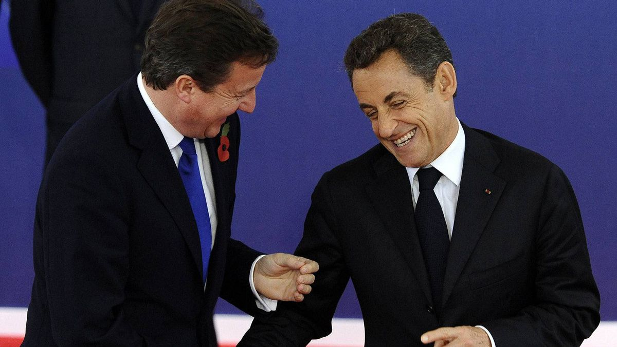 Sarkozy and British Prime Minister David Cameron share a laugh as Cameron arrives in Cannes for the G20 summit.