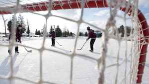 Kyle Trolley, from left, Nelson Armstrong and Mitch Bursey, all 15, pass the puck around on a frozen pond at a golf club in Peterborough, Ont. on Friday, Jan. 2, 2009 during -1C weather. The boys live next to the pond and bring their skates and shovels. THE CANADIAN PRESS/ Peterborough Examiner- Clifford Skarstedt Jr.