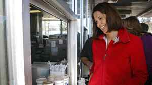 Alberta Wildrose leader Danielle Smith picks up a take out order at Peter's Drive-In while making a campaign stop in Calgary, Alta., Saturday, March 31, 2012. Albertans go to the polls on April 23.