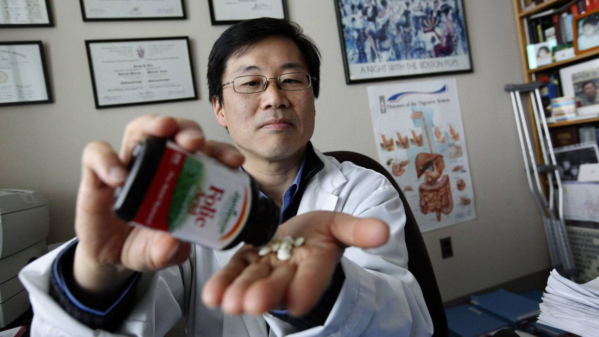 Dr. Young-In J. Kim, Gastroenterology and Hepatology at St. Michael's Hospital and also a professor at The University of Toronto, poses for a photo with Folic Acid at the hospital in Toronto, Ontario, Canada. Kim led a study that found the daughters of rats who took folic acid supplements before conception, during pregnancy and while breast-feeding have breast cancer rates twice as high as other rats. They also had more tumours and developed them at a faster rate. Kim also says there is more research that needs to be done to determine whether the findings also apply to humans. While there are similarities in breast cancer in rats and humans, there are differences in how rats and human metabolize folic acid.