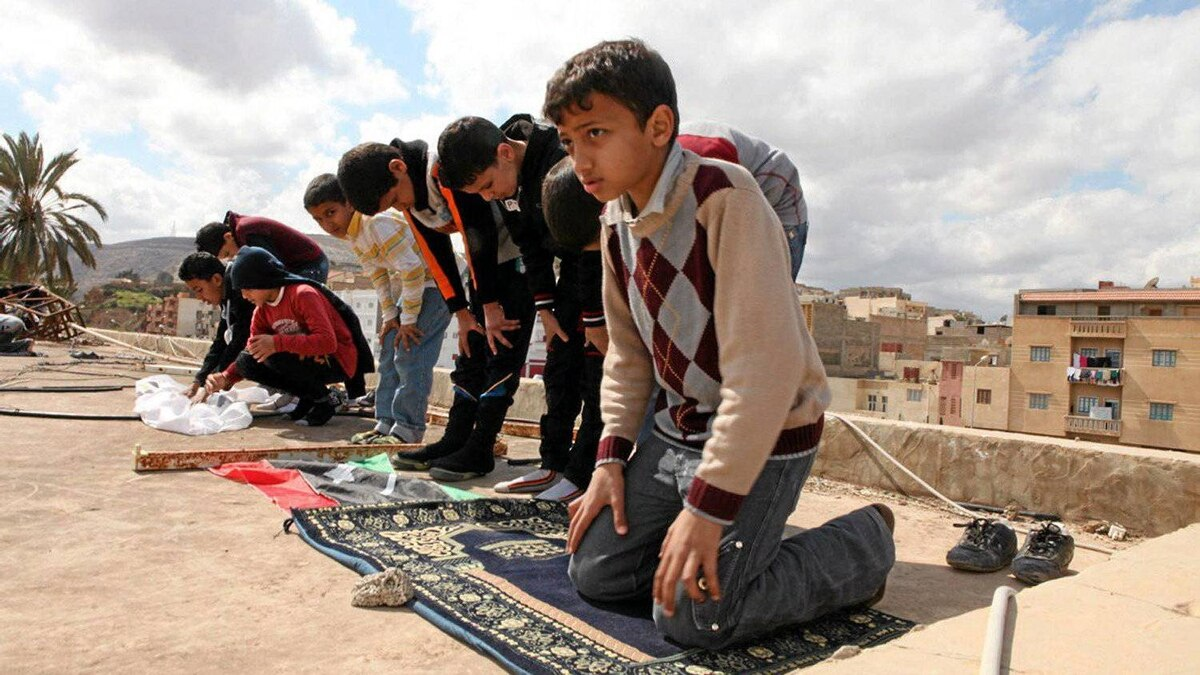 Friday prayers in the town of Darna, often described as a hotbed of religious extremism in Libya. Many of the town's anti-government fighters are organized by a commander who learned guerilla warfare at training camps in Afghanistan during the 1990s. Still, the new generation appears to see its armed struggle in more moderate terms.