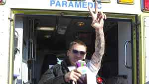 Veteran Pascal Lacoste flashes a peace sign as he is loaded on an ambulance, ending his hunger strike in front of Veterans Affairs Minister Steven Blaney's local riding office, Tuesday, November 8, 2011 in Levis, Que.