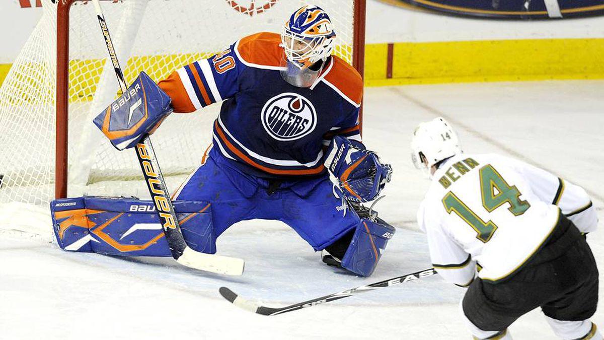 Dallas Stars' Jamie Benn, right, scores on the Edmonton Oilers' Devan Dubnyk during second period NHL hockey action in Edmonton on Friday, Jan. 22, 2010.