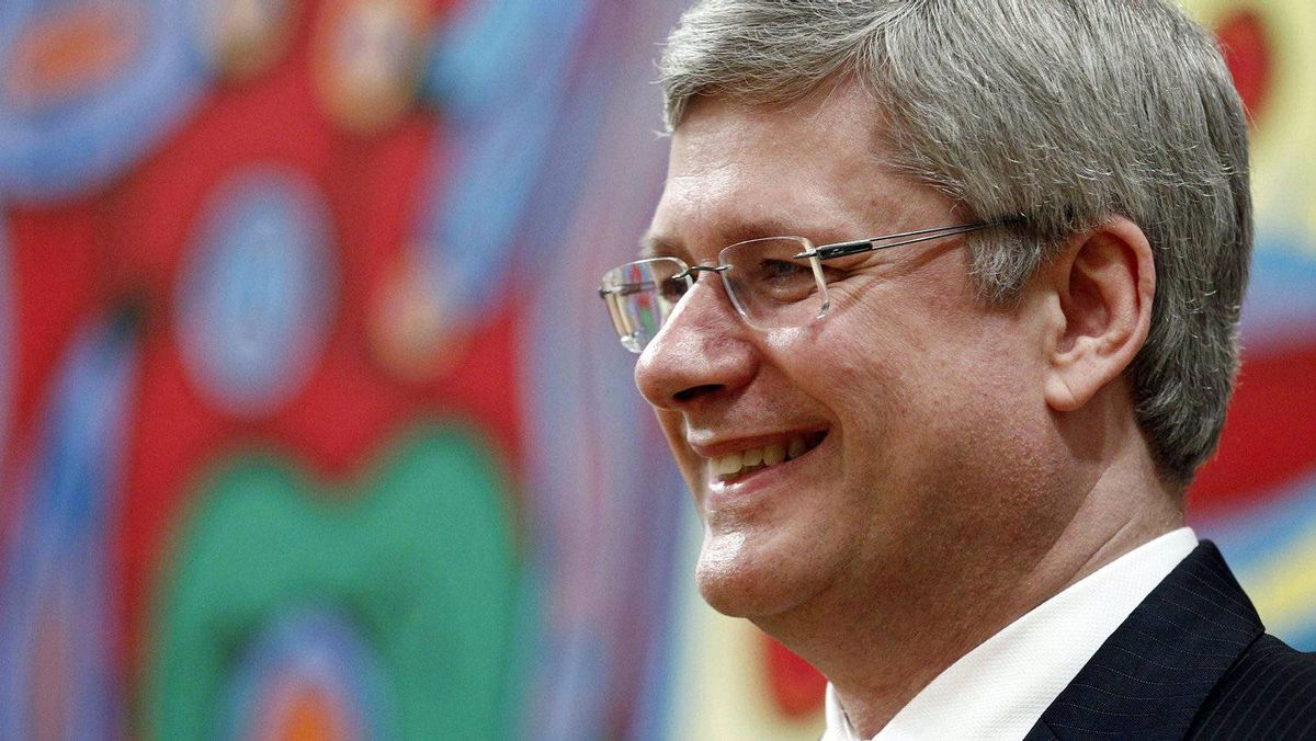 Prime Minister Stephen Harper smiles at his newly assembled cabinet ministers during a ceremony at Rideau Hall on May 18, 2011.