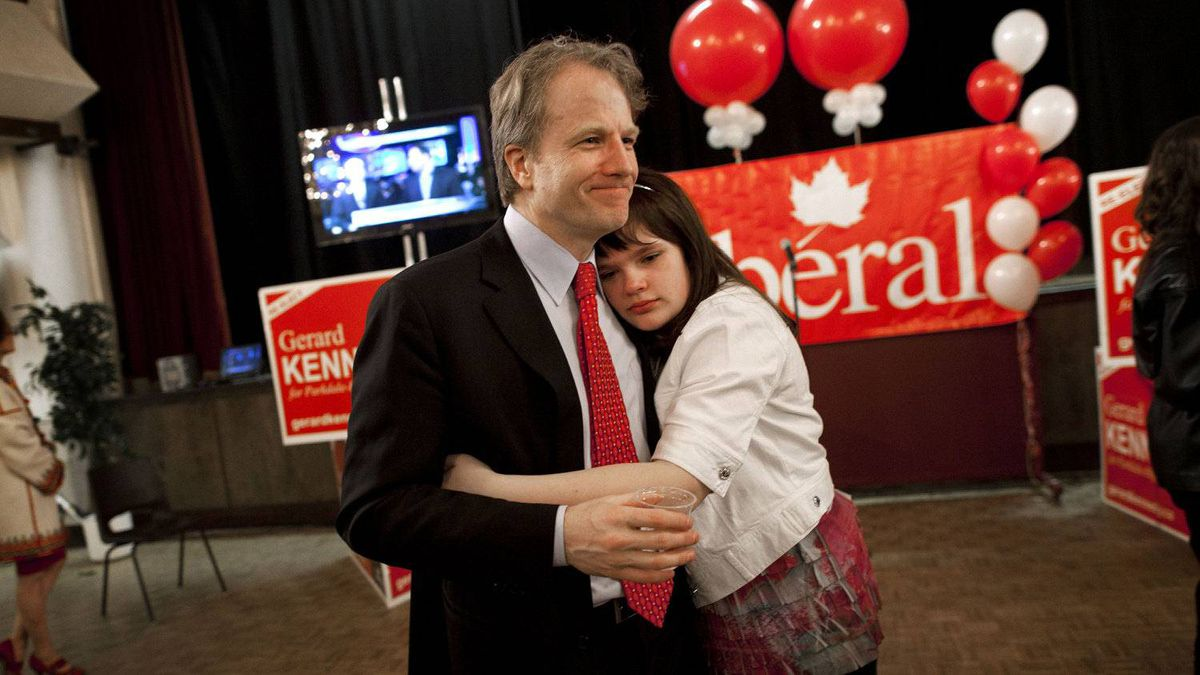 Liberal incumbent Gerard Kennedy gets a hug from daughter Theria after his defeat to the NDP candidate Peggy Nash in the Toronto riding of Parkdale-High Park.