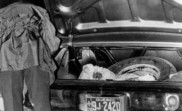 The body of Quebec labour minister Pierre Laporte is discovered in the trunk of a car on Oct. 17, 1970, at the St. Hubert Airport south of Montreal one week after he was kidnapped by FLQ terrorists.