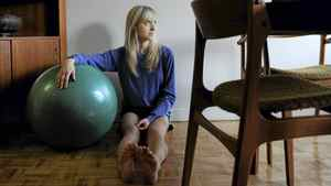 Emily Nicholas, 29, is photographed exercising with her yoga ball in her Toronto home on Dec 20 2011. After a stress fracture in her leg was misdiagnosed, she eventually broke it in a fall and has since undergone several operations to correct the problem.