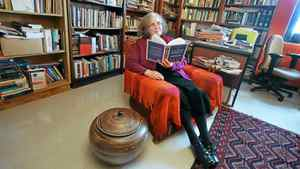 Poet and educator Mary Dalton reads in her office at Memorial University of Newfoundland.