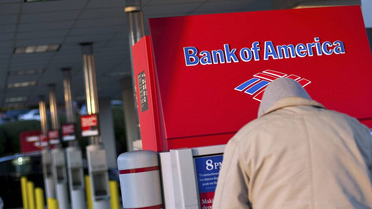 A Bank of America customer uses an ATM machine at a branch in Greenville, S.C.