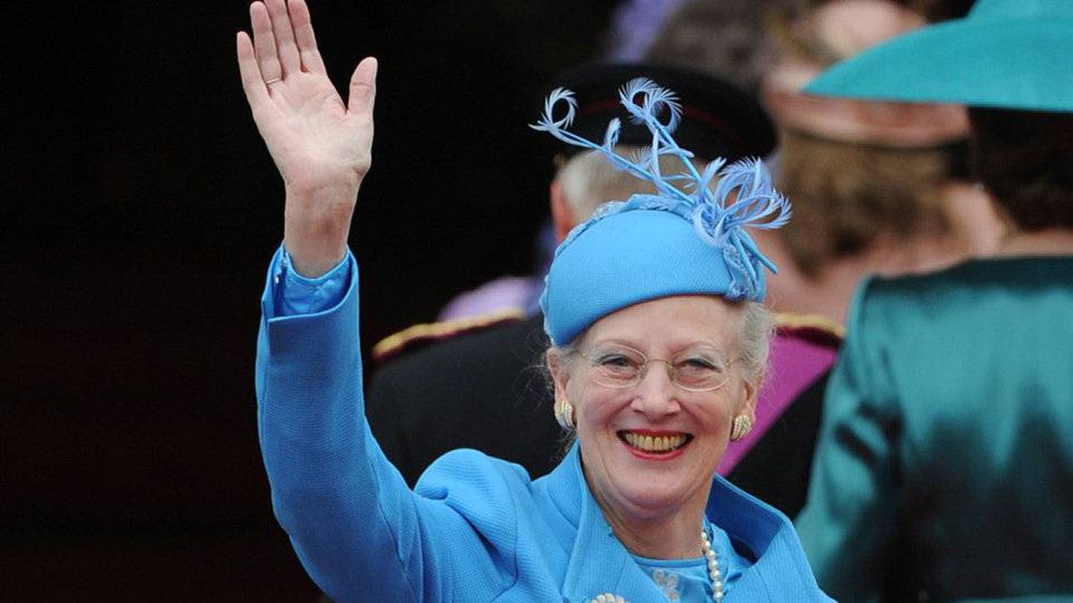 The Queen Margrethe of Denmark waves as she arrives at the West Door of Westminster Abbey