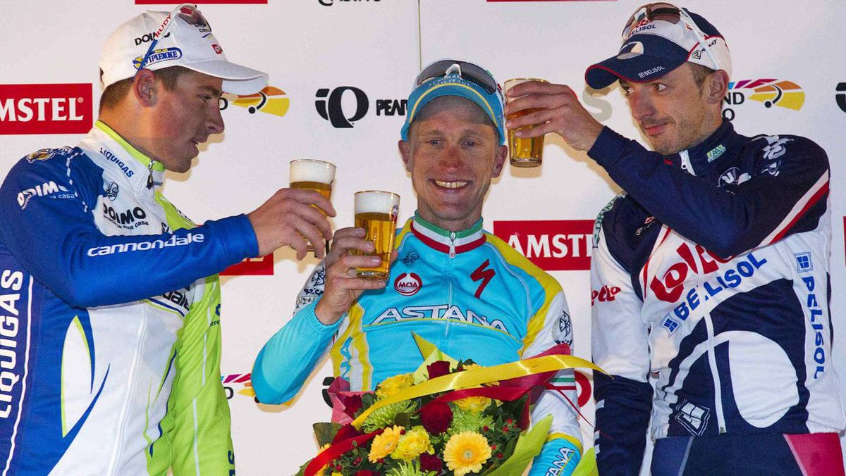 Enrico Gasparotto of Astana (C), Peter Sagan of Liquigas-Cannondale (L) and Jelle Vanendert of Lotto-Belisol celebrate with beer on the podium after the 47th Amstel Gold Cycling race in Valkenburg April 15, 2012. REUTERS/Michael Kooren