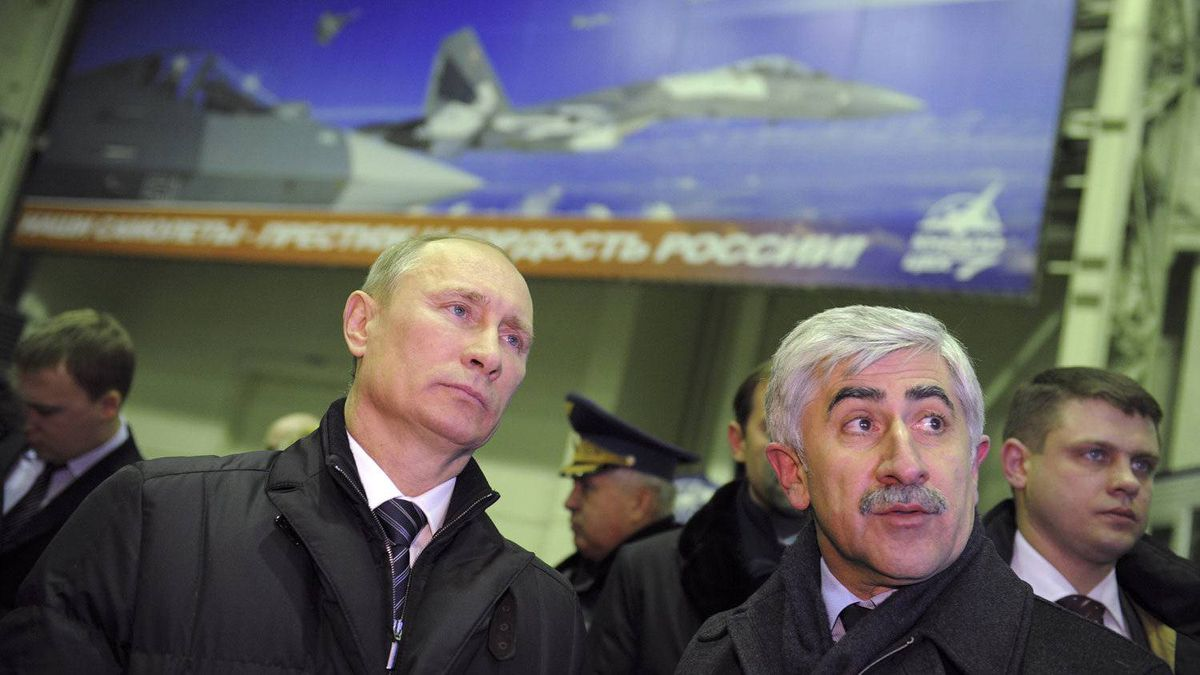 Russia's Prime Minister Vladimir Putin, left, visits an aircraft production workshop with Mikhail Pogosyan, president of United Aircraft Corp., in Komsomolsk-on-Amur in Russia's Far East, on Feb. 20, 2012.