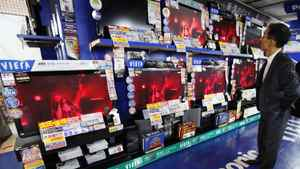 A man looks at Panasonic Corp's Viera televisions displayed at an electronics store in Tokyo October 31, 2011.