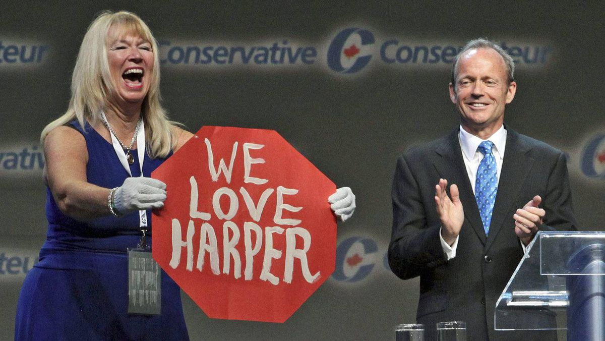Valerie Day offers her twist on a Senate page's 'Stop Harper' protest during a speech by her husband, former Treasury Board president Stockwell Day, to the Conservative Party policy convention in Ottawa on June 9, 2011.