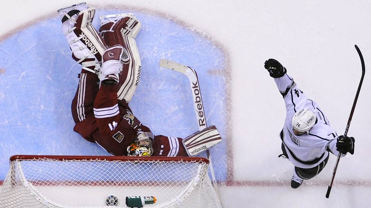 Los Angeles Kings' Dwight King (R) celebrates his second period goal on Phoenix Coyotes' goalie Mike Smith during Game 1 of the NHL Western Conference hockey finals.