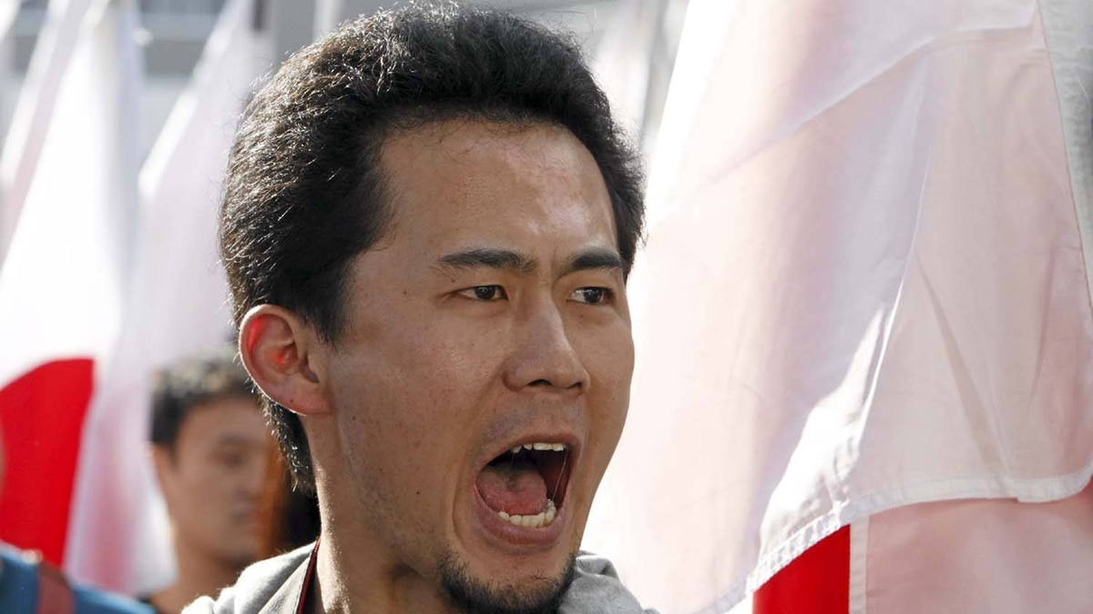 A protester shouts slogans during a rally at Tokyo's Shibuya district October 2, 2010. Thousands of people gathered and marched on Saturday to protest China's claims to the disputed islands in the East China Sea, known as the Senkaku islands in Japan and Diaoyu in China.