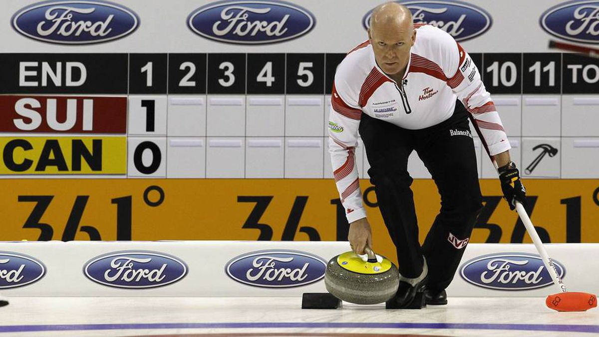 Canada skip Glenn Howard delivers his stone during play against Switzerland at the World Men's Curling Championship 2012 in Basel April 3, 2012.