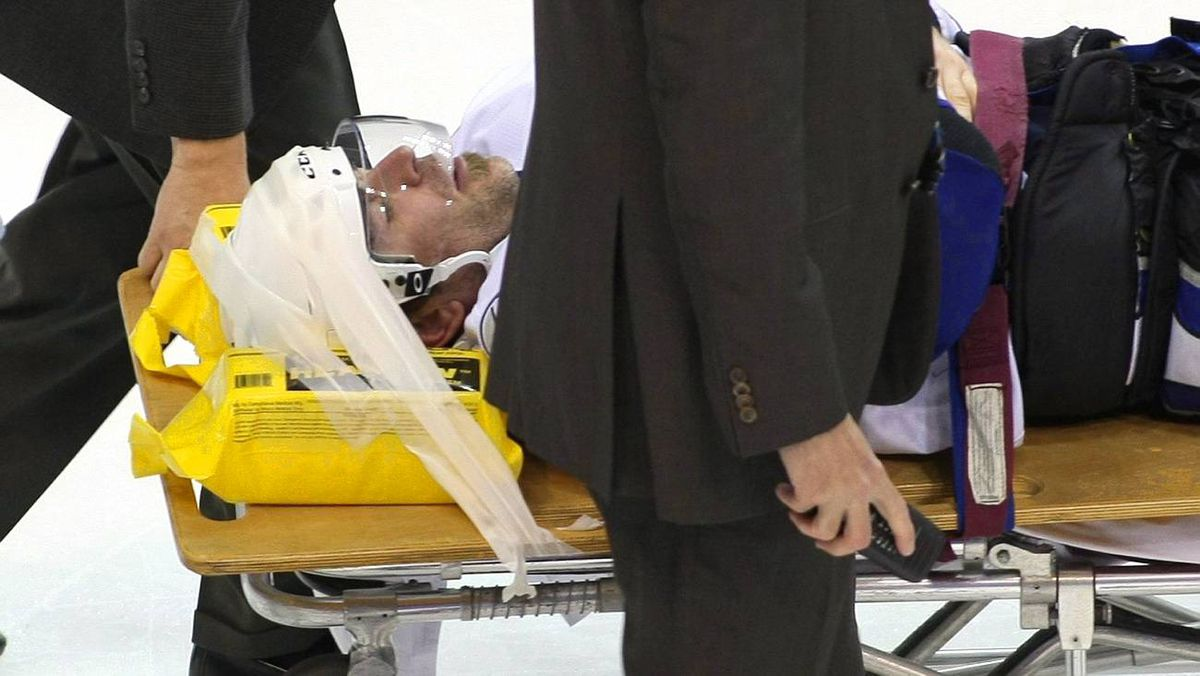 Jamie Heward of the Tampa Bay Lightning is taken off the ice on a stretcher after being checked into the boards in this Jan. 1, 2009 file photo in Washington.