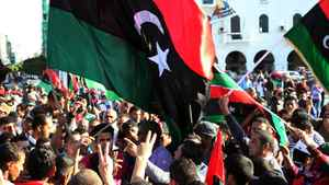 """Libyans celebrate the capture of Seif al-Islam, fugitive son and one-time heir apparent of murdered leader Moamer Kadhafi, in the capital Tripoli on November 19, 2011. Seif al-Islam, 39, who is wanted by the International Criminal Court (ICC), was """"arrested in southern Libya"""" by former rebel forces, National Transitional Council (NTC) justice minister Mohammed al-Allagui told AFP, declining to give any details."""