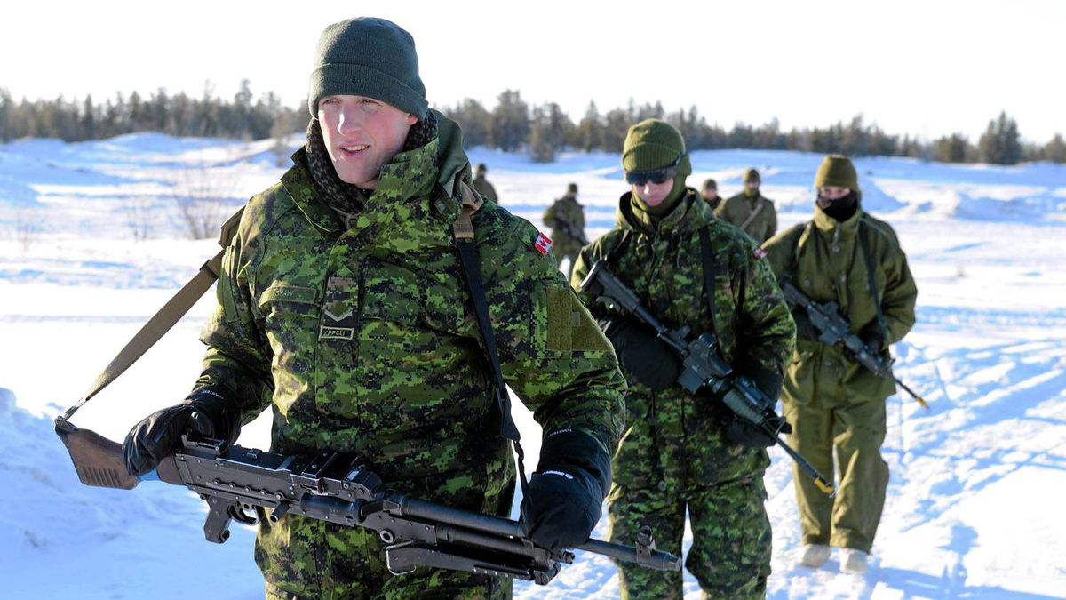 Soldiers of the 3rd Battalion of Princess Patricia's Light Infantry (PPCLI) practise battle procedure on an open field in Forward Operational Base (FOB) Wolf, in Yellowknife during Exercise ARCTIC RAM.
