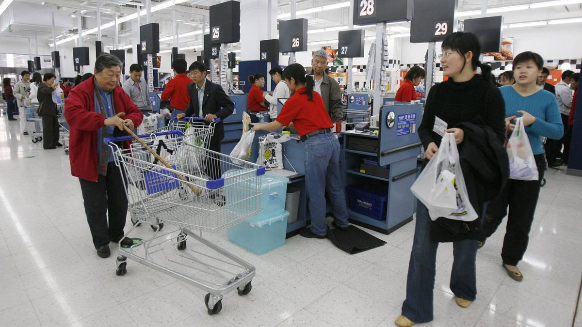 Shoppers at a Wal-Mart store in Beijing. Lowering taxes for the poor and consumers will make China's people feel richer, and spend more.