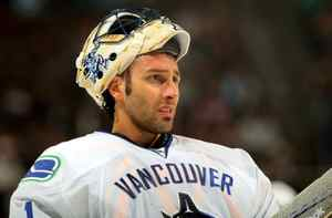 Goaltender Roberto Luongo of the Vancouver Canucks looks on during a break in the action against the Colorado Avalanche during NHL action at the Pepsi Center on October 3, 2009 in Denver, Colorado. Luongo had 24 saves while giving up three goals as the Avalanche defeated the Canucks 3-0.