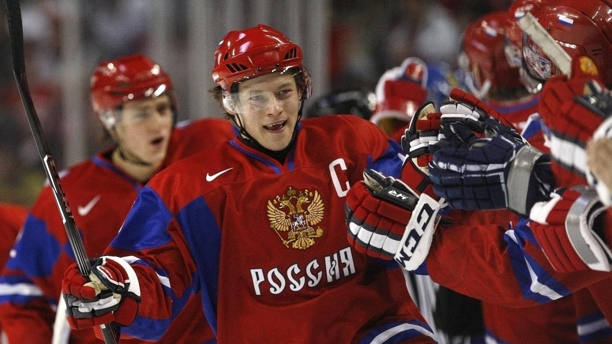 Russia's Vladimir Tarasenko is congratulated by teammates after scoring on Sweden during the first period of their semi-final game at the IIHF World Junior Hockey Championships in Buffalo.