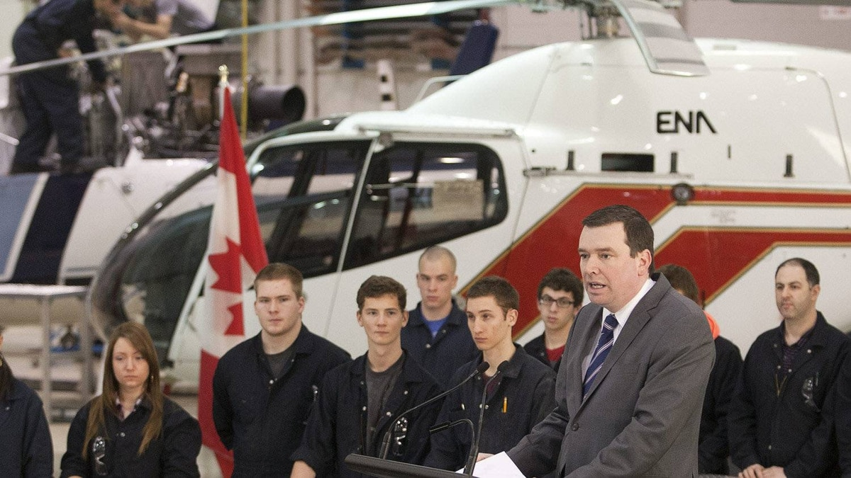 Federal Industry Minister Christian Paradis announces a review of federal aerospace and space policies on Monday at an aerospace school in Longueuil, Que.