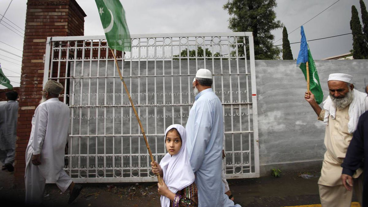 A lone little girl marches with pro-Taliban supporters in Rawalpindi, Pakistan, on May 6, 2011.