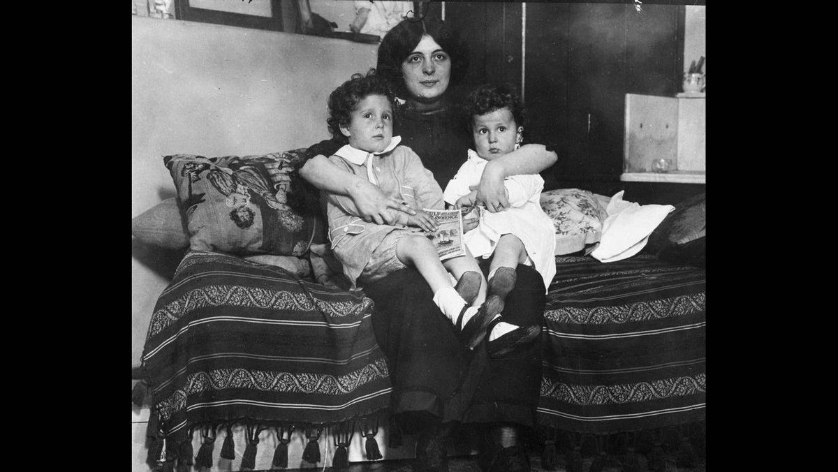 Edmond and Michel Navratil, of Nice, France, on their mother Marcelle's lap after being reunited with her, 1912. Michel and Edmond, ages four and two, better known as the 'Titanic Orphans' were the only children rescued from the Titanic without a parent or guardian. The children, who spoke no English, were cared for by first-class French-speaking passenger Margaret Hays until their mother was located in France. Their father placed the two in the last lifeboat successfully launched from the Titanic.