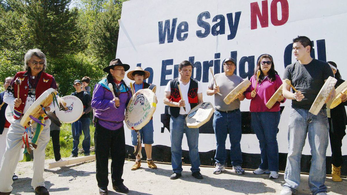 """Traditional drummers from a number of British Columbia coastal First Nations perform at Kitamaat Village, B.C., Saturday May 29, 2010, after the community raised a sign to protest against plans by Enbridge to build a bitumen pipeline from the Alberta oil sands and then send it by tanker to Asia. The """"Solidarity Gathering of Nations"""" was sponsored by the Haisla and Gita'at First Nations, Kitamaat Village, B.C."""