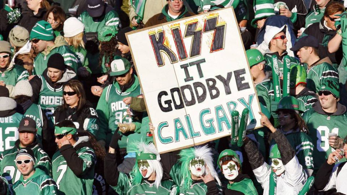 Saskatchewan Roughriders' fans cheer their team during first half CFL Western final football action against the Calgary Stampeders in Regina, Sunday, Nov. 22, 2009. THE CANADIAN PRESS/Jeff McIntosh