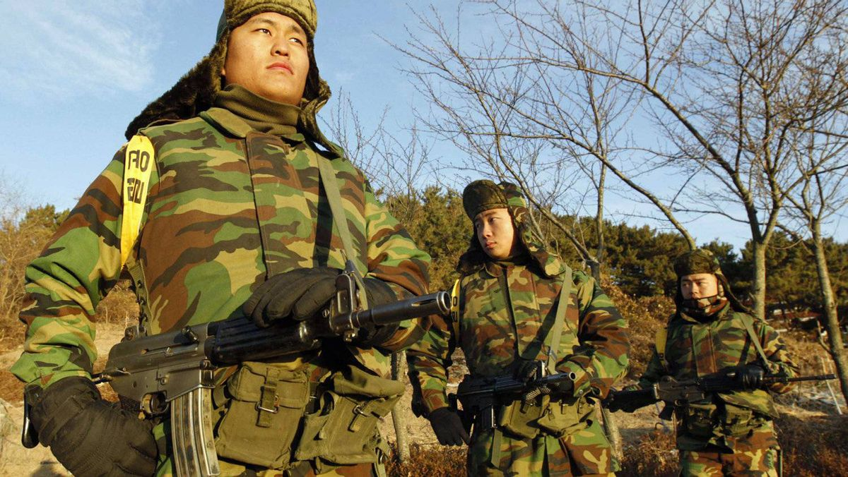 South Korean marines stand guard on Nov. 26, 2010, at a check point on Yeonpyeong Island, which was shelled by North Korea.