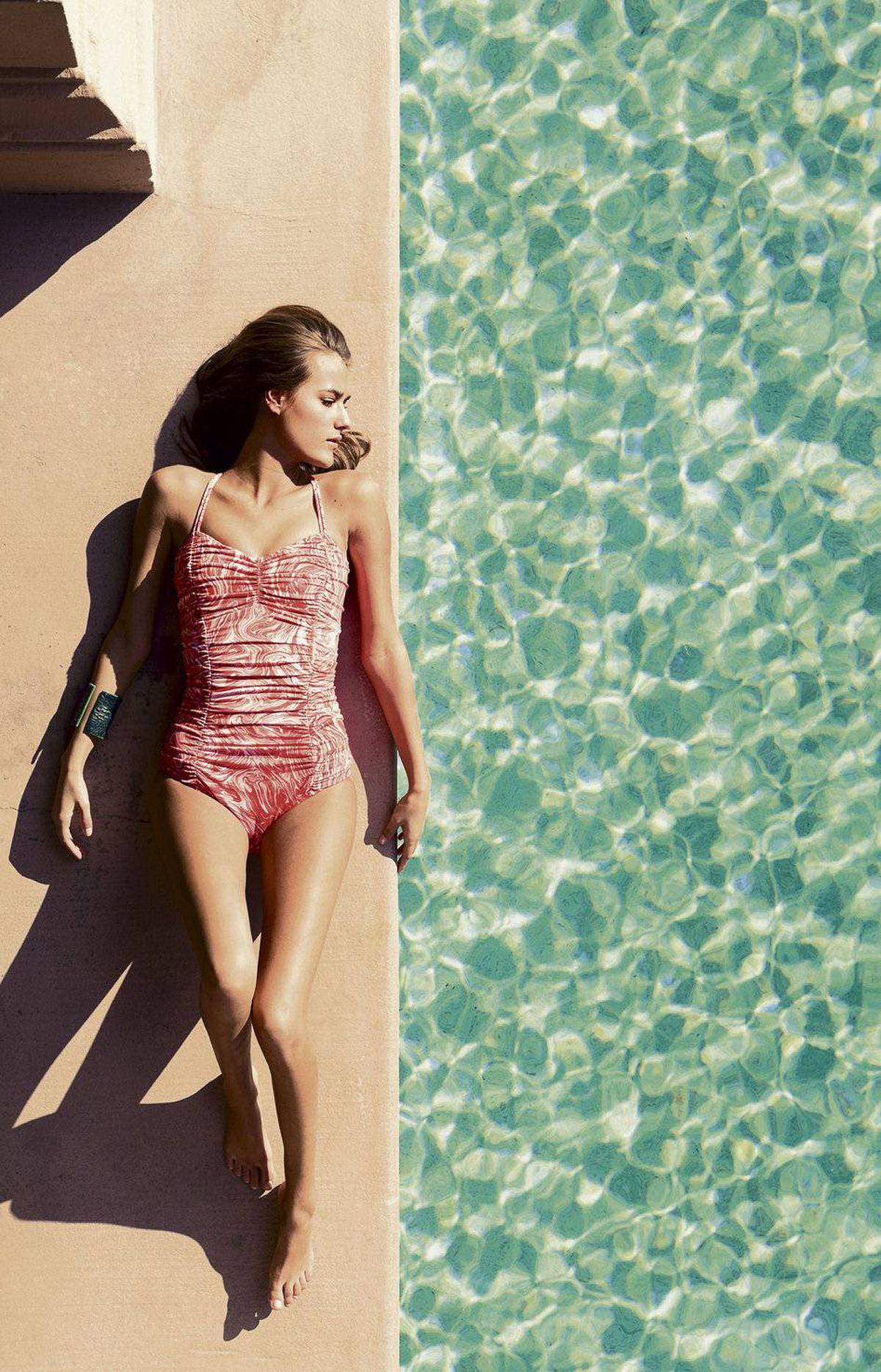 Michael Kors swimsuit, $309 at Holt Renfrew. Dandi Maestre cuff, $350.