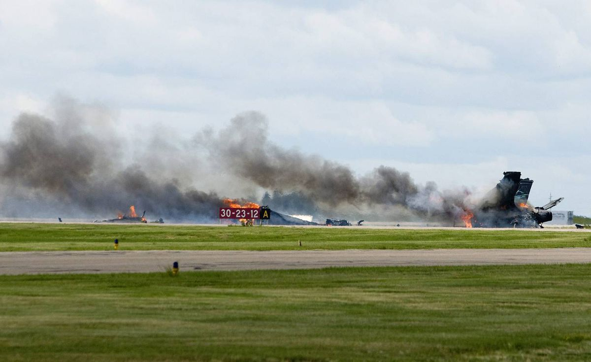 A CF-18 fighter jet burns on the ground after it crashed during a practice flight for this weekend's Alberta International AirShow in Lethbridge, Alta., at the Lethbridge County Airport. The pilot ejected before impact.
