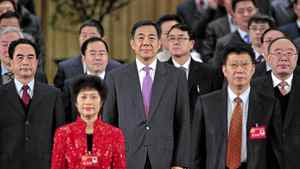 China's former Chongqing Municipality Communist Party Secretary Bo Xilai (C) and former Deputy Mayor of Chongqing Wang Lijun (Bo's L) at a session of the Chinese People's Political Consultative Conference (CPPCC) of the Chongqing Municipal Committee January 7, 2012.