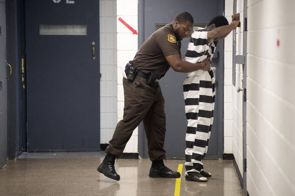 "04376cebf49 Corrections Officer Terence Moore frisks an inmate before the inmate meets  with his attorney at the Saginaw County Jail. Sheriff Federspiel said ""some  ..."