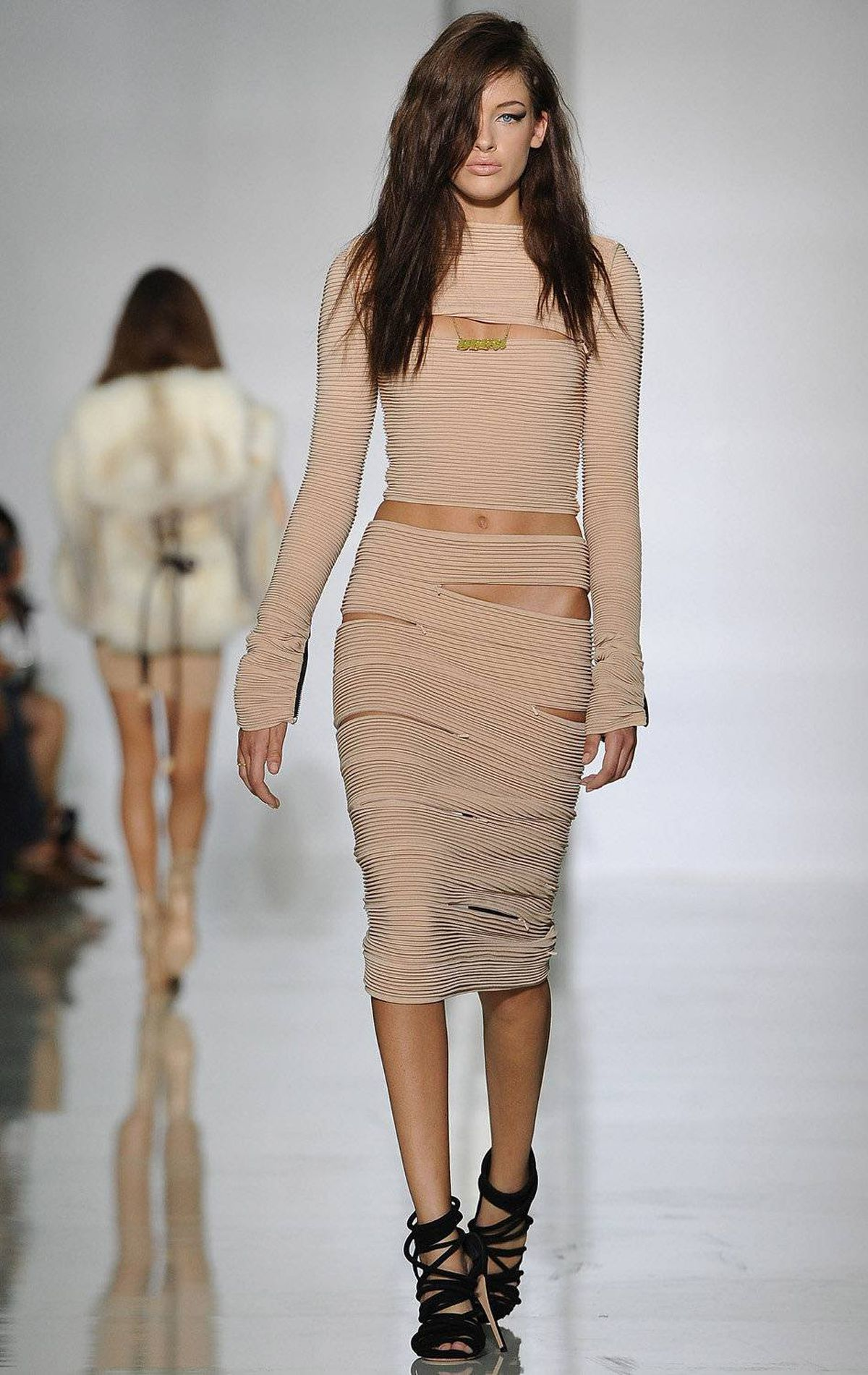 A model walks the runway during the Dw by Kanye West ready-to-wear spring/summer 2012 show during Paris Fashion Week at Lycee Henri IV on October 1, 2011 in Paris.