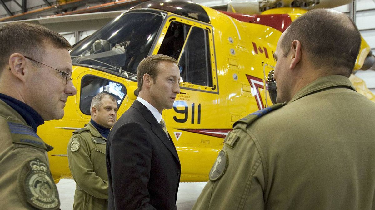 Defence Minister Peter MacKay speaks with search-and-rescue personnel in front of a CH-149 Cormorant helicopter in Halifax on Sept. 12, 2007.