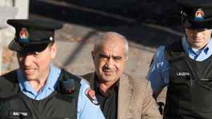 Mohammad Shafia is led into court in Kingston Ontario on Tuesday October 11, 2011.