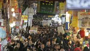 Iranians walk in a corridor of the main old Bazaar of Tehran, Iran, Thursday, Jan. 26, 2012.