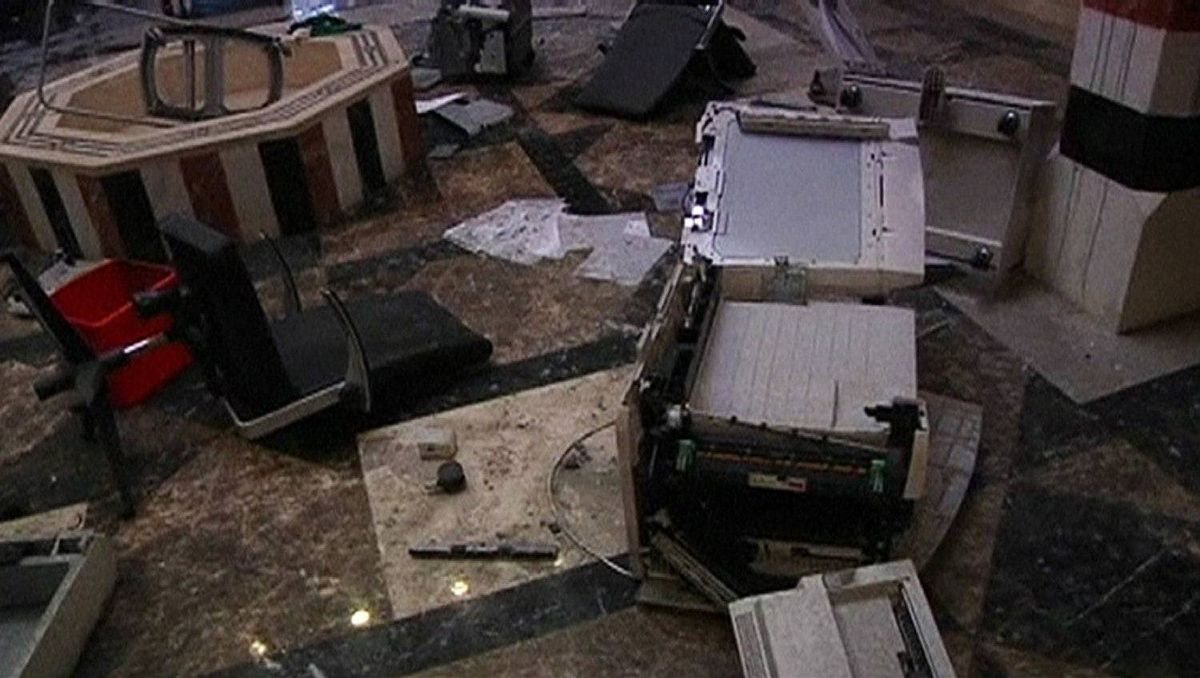 Damaged equipment is scattered on the ground of the Syrian embassy after it was ransacked by protesters, in Cairo, in this still image taken from video February 4, 2012.